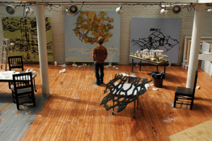 Matthew Ritchie in his studio. Photograph of a sculpture by Joe Fig.